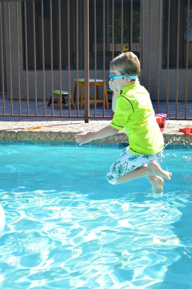 Carter jumping into pool