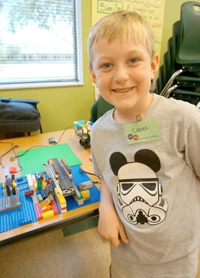 carter with his conveyor belt on display