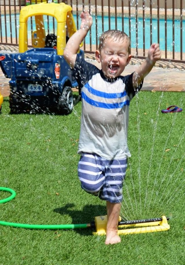 harry-running-through-sprinkler