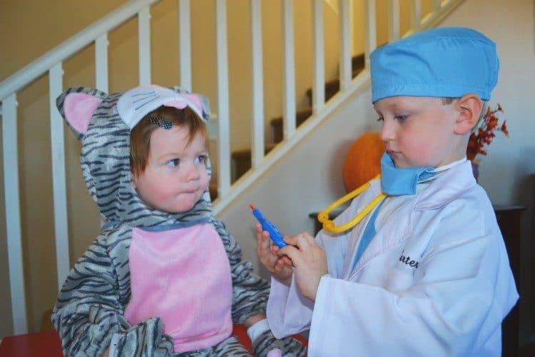 Veterinarian and cat costumes