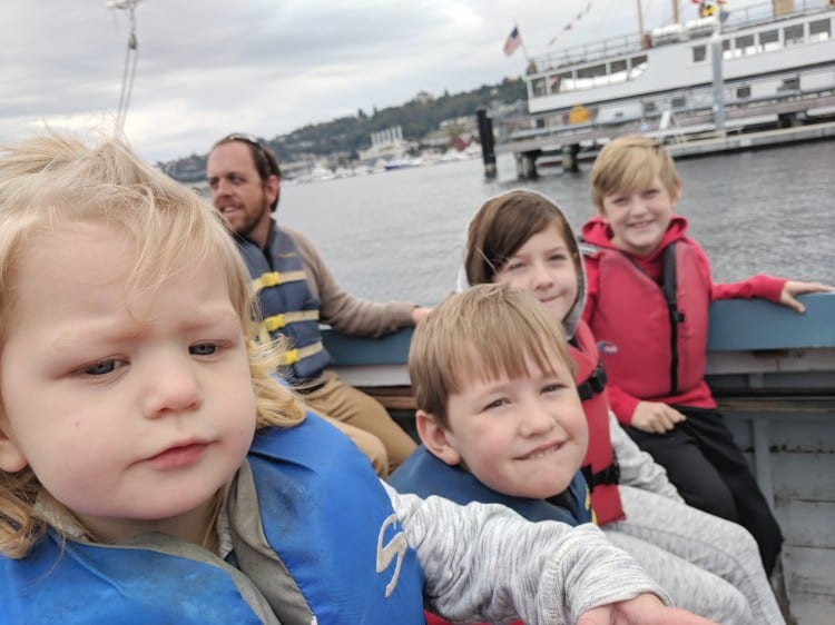 kids on wooden sailboat