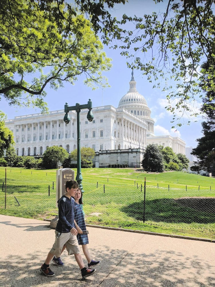 kids walking by the capitol building