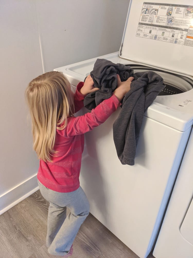 Melody doing laundry