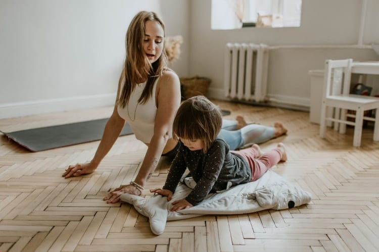mom exercising with toddler