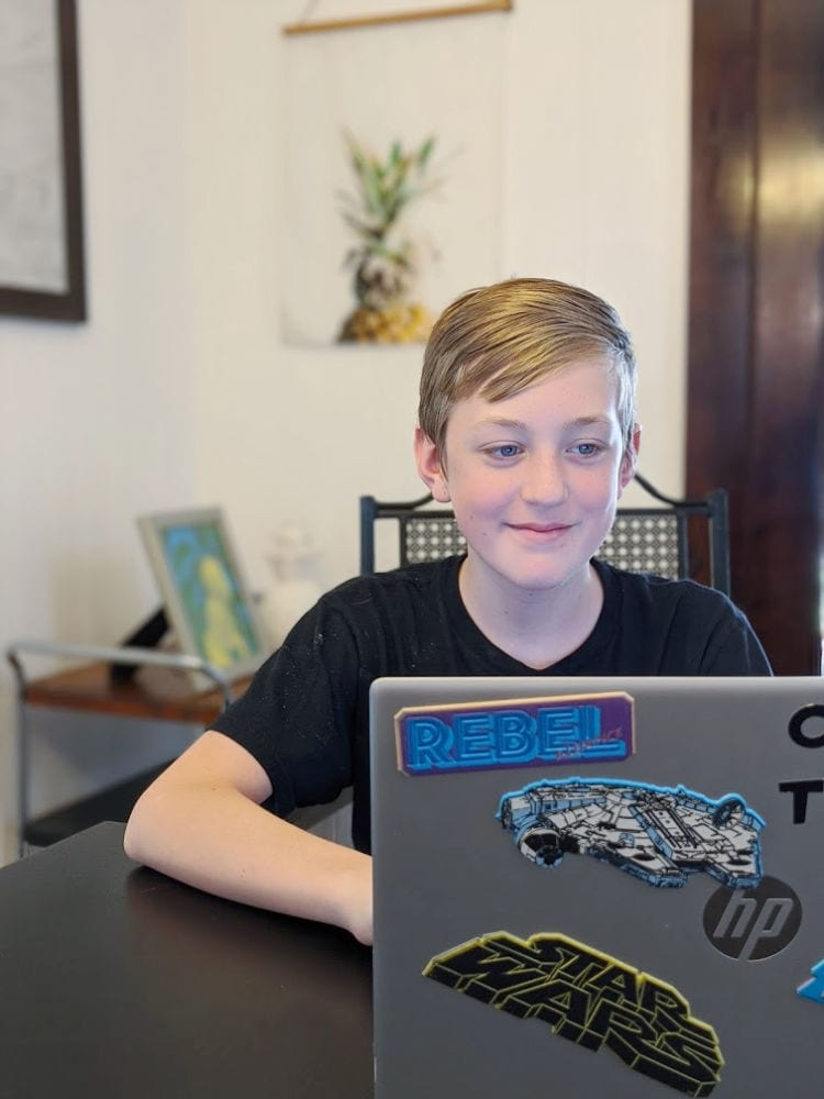 Carter working on laptop