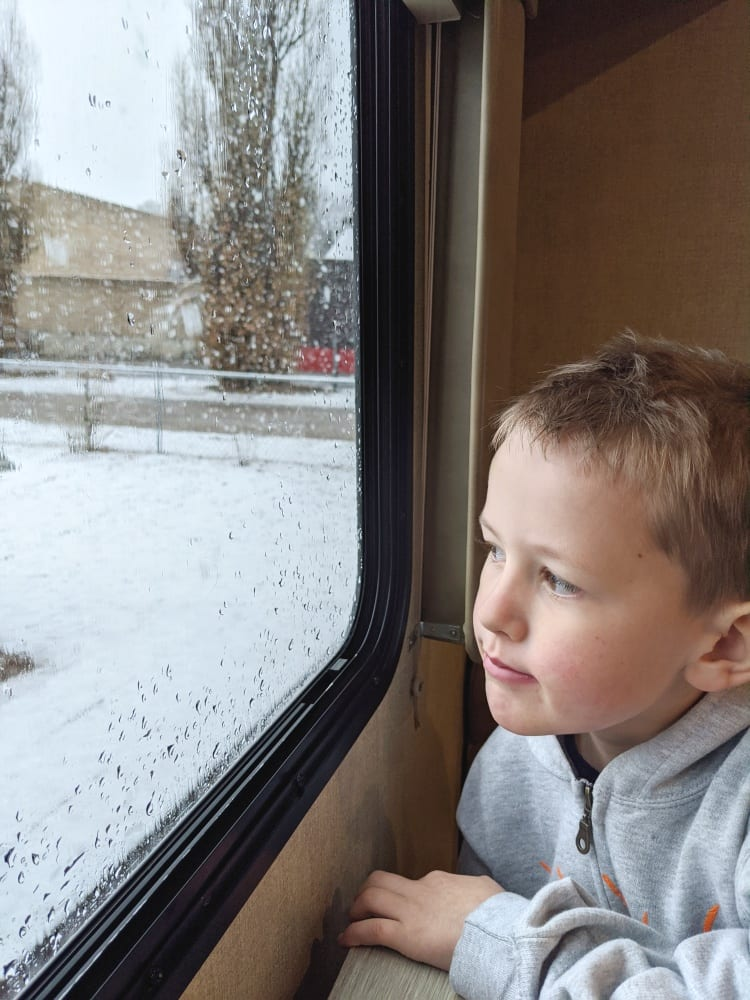 harry looking out RV window