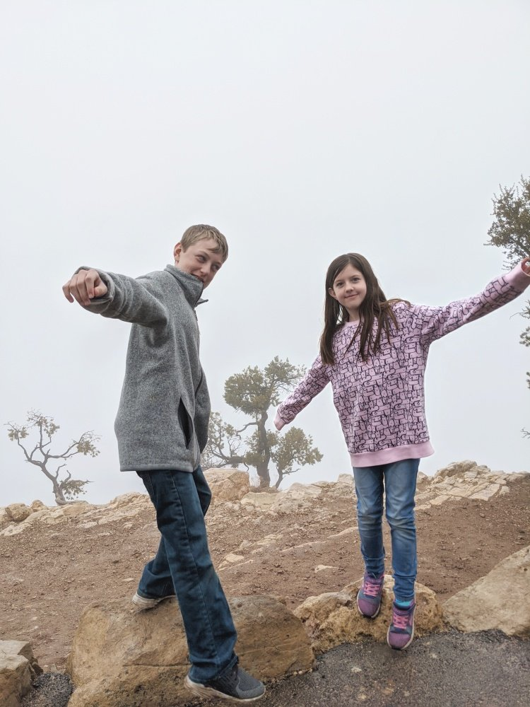 kids at foggy Grand Canyon