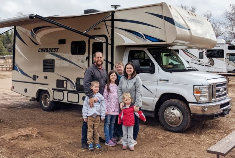 family in front of RV