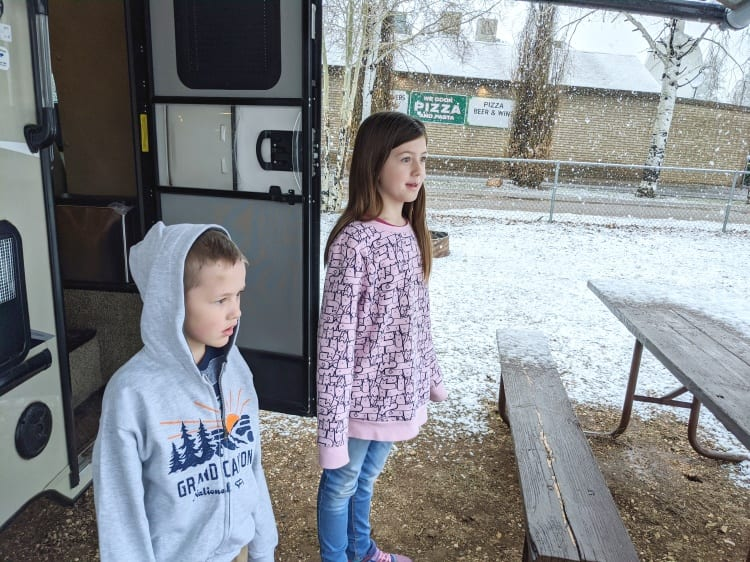 kids seeing snow at campsite