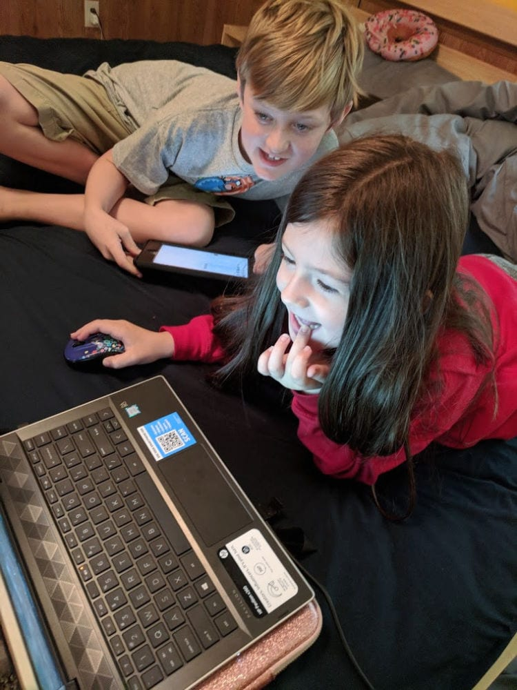Carter and Vanessa on laptop