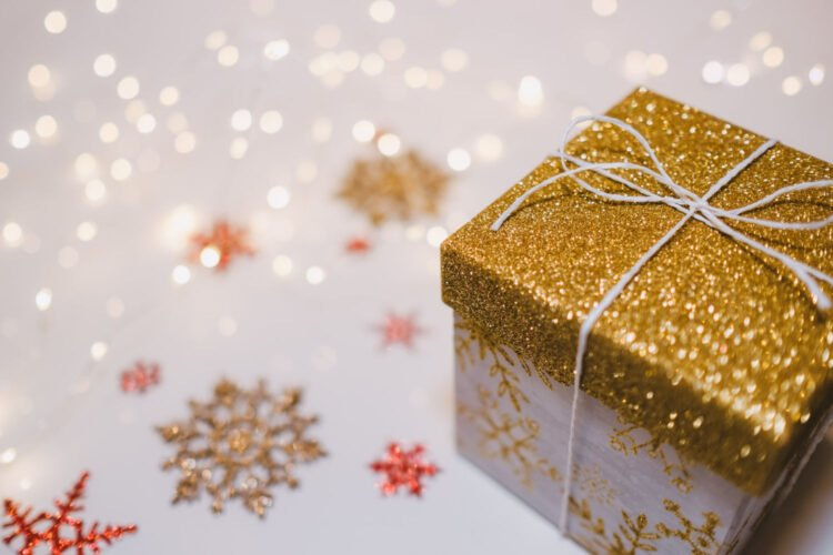 Image of Christmas present with starry background